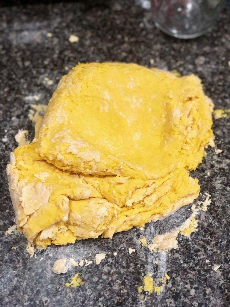 yellow dough that has been kneeded