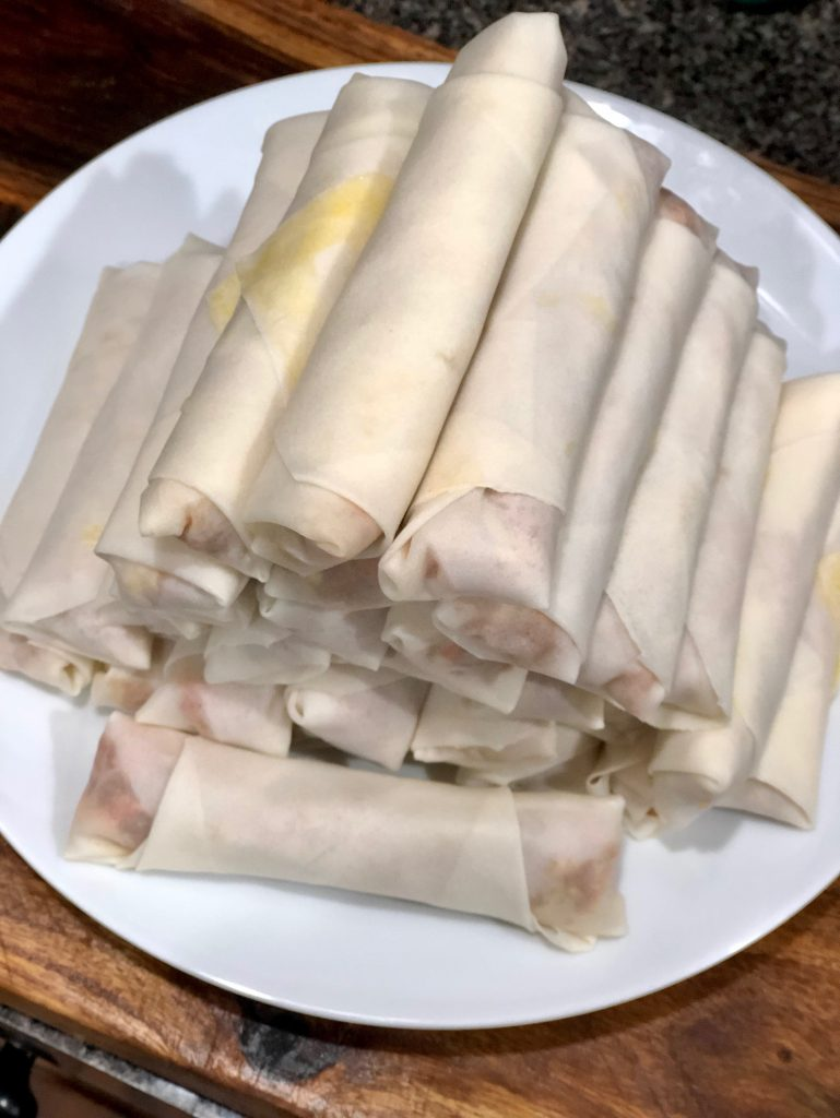 a pyramid of wrapped spring rolls